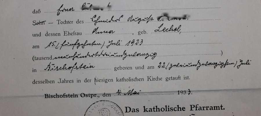 Częściowo nieczytelny dokument parafialny wystawiony w maju 1933 roku w Bisztynku.