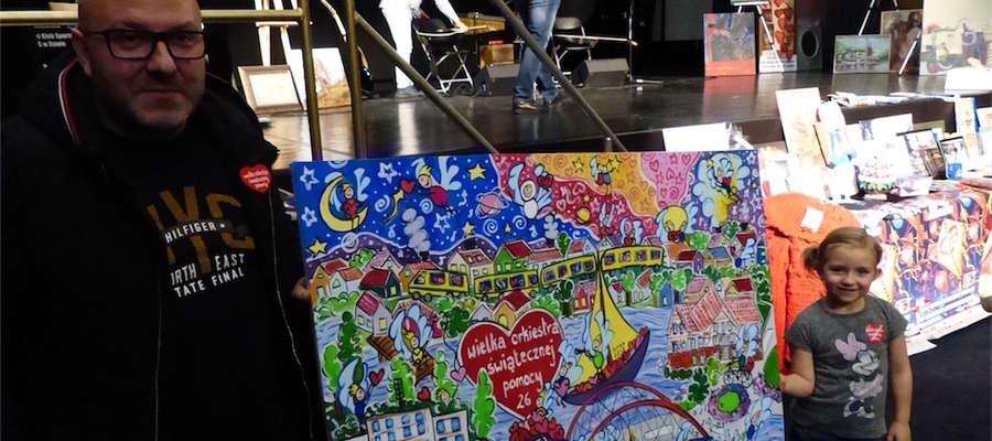 Pan Tomasz z Iławy z córką Kornelią wylicytowali obraz Kasi Kordalskiej z symboliką Orkiestry